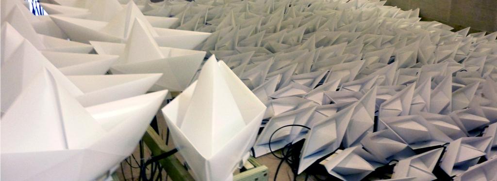 assembled paper boat for Voyage